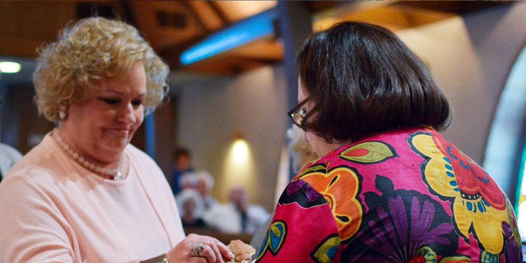 Lady receiving communion